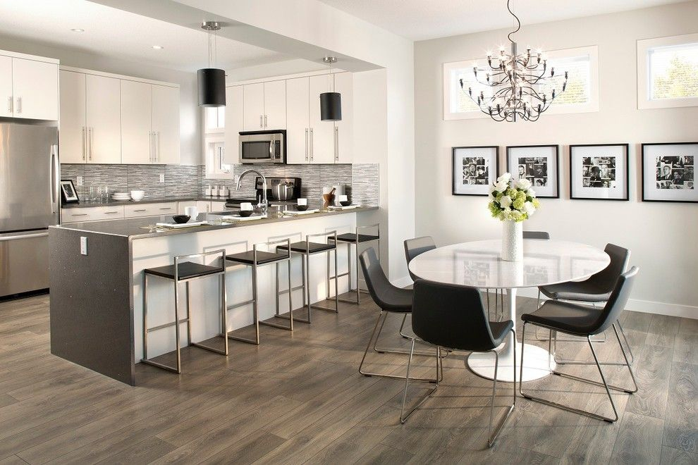How to Clean Pergo Floors for a Contemporary Dining Room with a Oval Dining Table and New Showhomes! (Calgary + Edmonton) by Sabal Homes