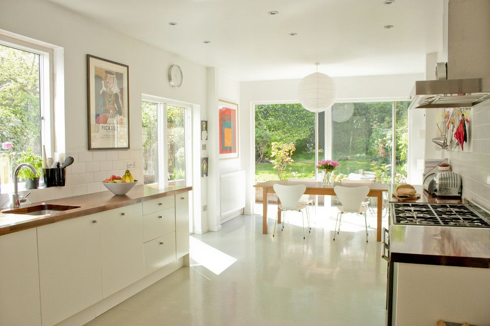 How to Clean Pergo Floors for a Contemporary Kitchen with a Metro Tile and Dining Room by Dhv Architects