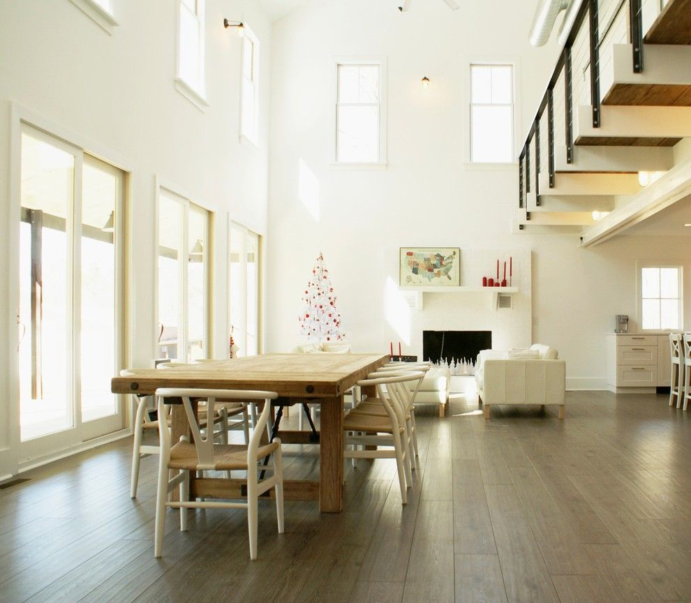 How to Clean Pergo Floors for a Farmhouse Dining Room with a White and Country Cathedral by Linton Architects