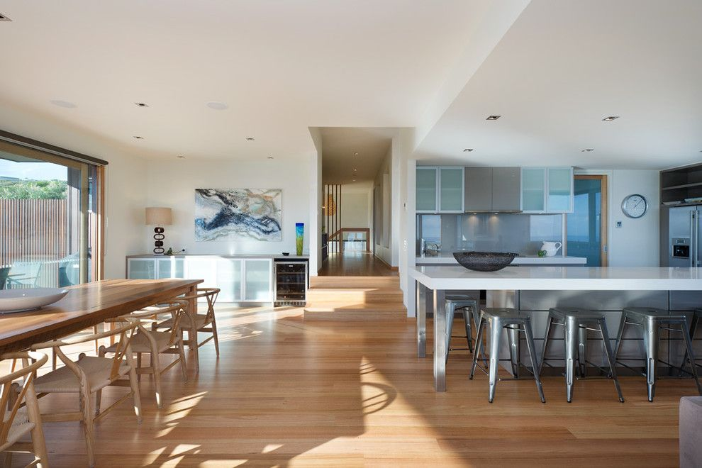 How to Clean Pergo Floors for a Modern Dining Room with a Frosted Glass Cabinet and Mark Gleeson Design by Matthew Mallett Photography