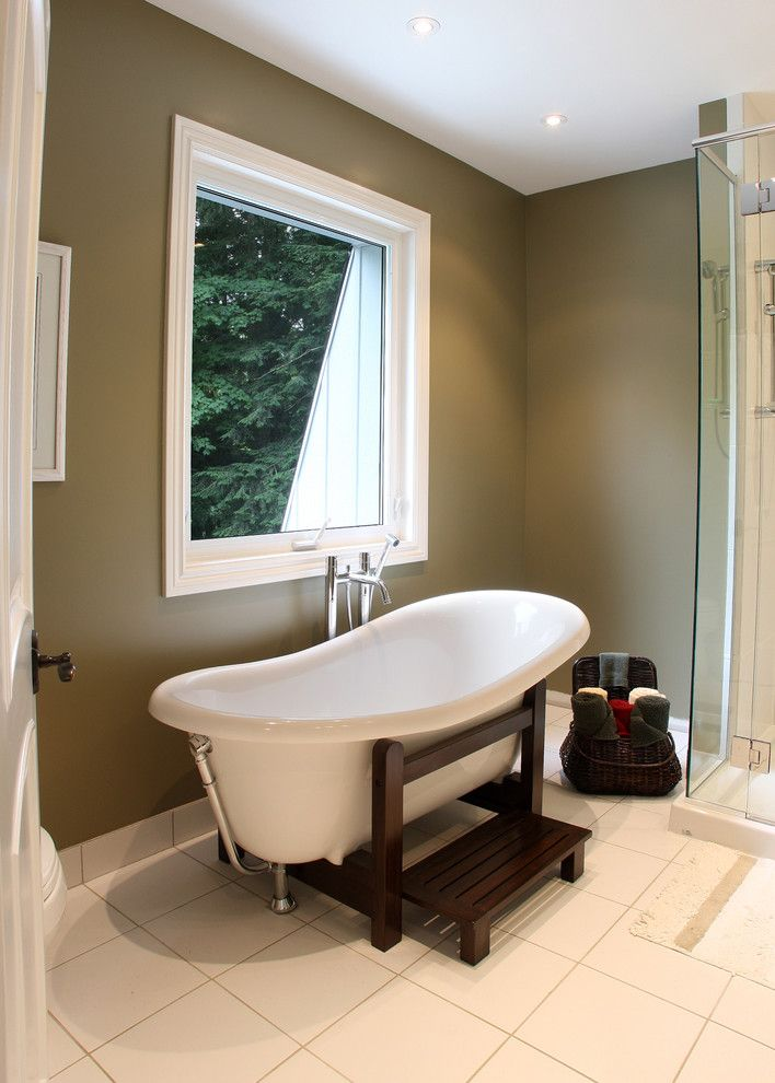 How to Clear a Clogged Drain for a Traditional Bathroom with a Tub Stand and St Clements Master Bath by Schnarr Craftsmen Inc