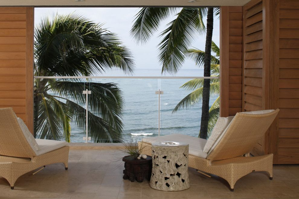 How to Get Rid of Cat Spray Smell for a Tropical Deck with a Lanai and Waterfront Grace by Philpotts Interiors