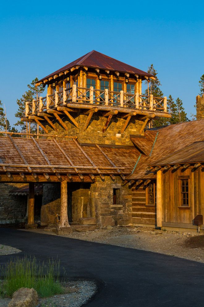 How to Get Skunk Smell Out of House for a Rustic Exterior with a Stone Wall and Foxtail Residence by Teton Heritage Builders