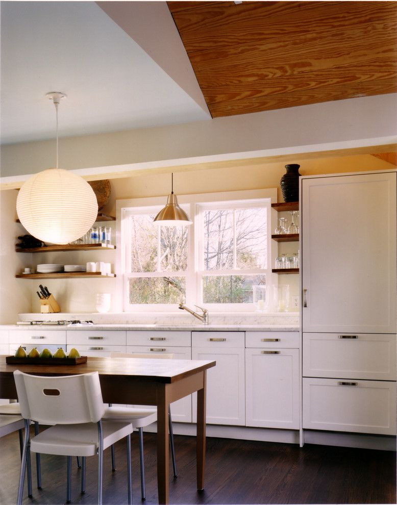 How to Hang Floating Shelves for a Rustic Kitchen with a Panel Refrigerator and Kitchen by Paul Rice Architecture