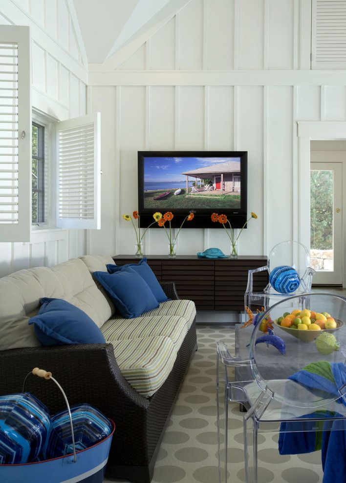 How to Hang Pictures on Plaster Walls for a Beach Style Living Room with a Lake House and Profile by Siemasko + Verbridge