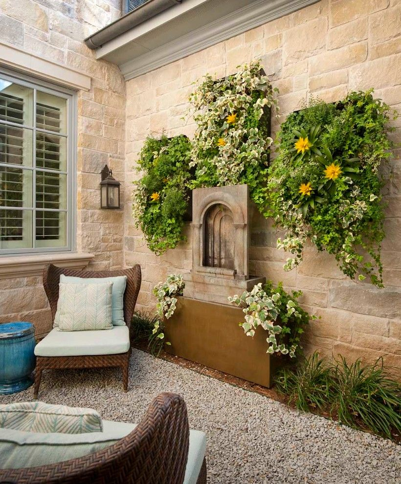 How to Hang Pictures on Plaster Walls for a Traditional Patio with a Planter Box and Lupton by Danes Custom Homes