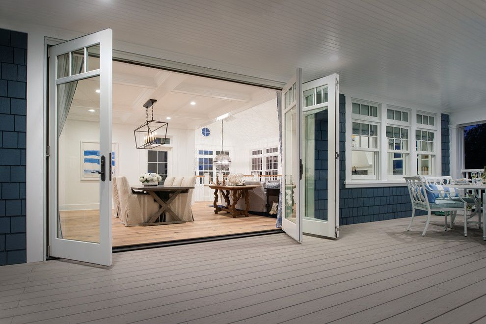 How to Install Bifold Doors for a Contemporary Deck with a Blue Shingle Siding and Marvin Windows and Doors by Marvin Windows and Doors