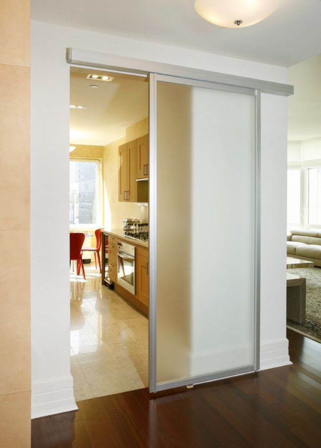 How to Install Bifold Doors for a Contemporary Kitchen with a Nyc Apartment and Frosted Sliding Door by Disalvo Interiors