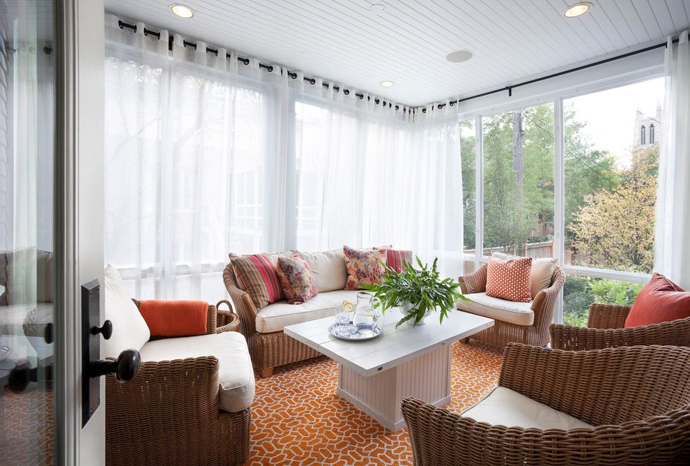 How to Install Curtain Rods for a Transitional Sunroom with a Orange Rug and Hyde Park Renovation by Tom Stringer Design Partners