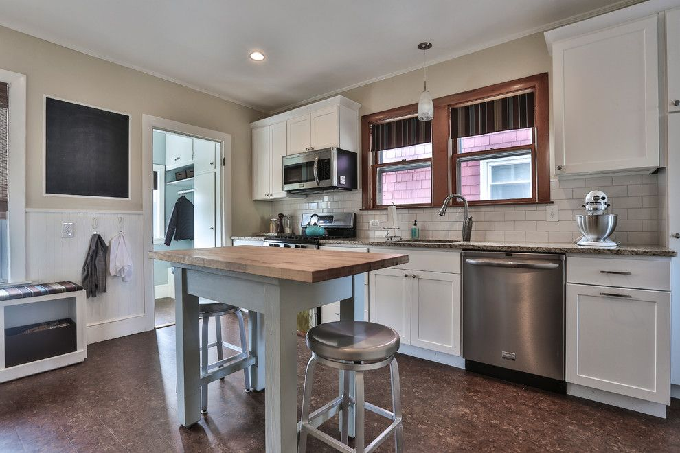How to Install Pergo Flooring for a Traditional Kitchen with a Double Hung Window and Lawrence Street by Wendy Hynes