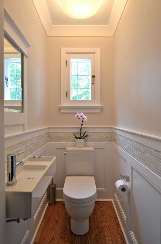 How to Install Pergo Flooring for a Traditional Powder Room with a Tile Stripe and Powder Room Renewal   by Design Cube Inc.