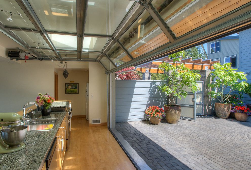 How to Install Prehung Door for a Beach Style Kitchen with a Paved Patio and Courtyard Kitchen with Door Up. by Dan Nelson, Designs Northwest Architects