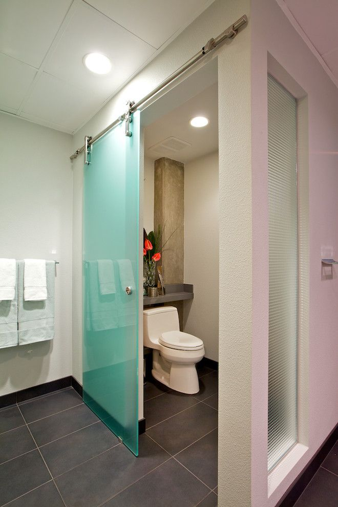 How to Install Prehung Door for a Contemporary Bathroom with a Purple Wall and Downtown San Diego Loft Remodel by Yearley Interiors