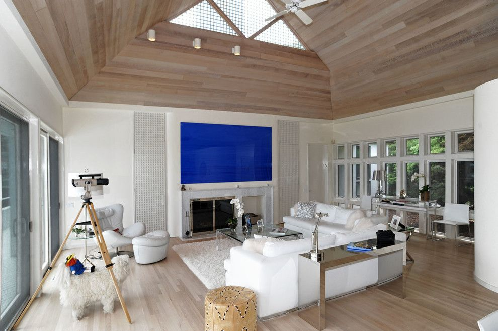 How to Lay Laminate Floor for a Contemporary Living Room with a Blue Artwork and Hamptons Modern Living Room by Susanne Kelley Design