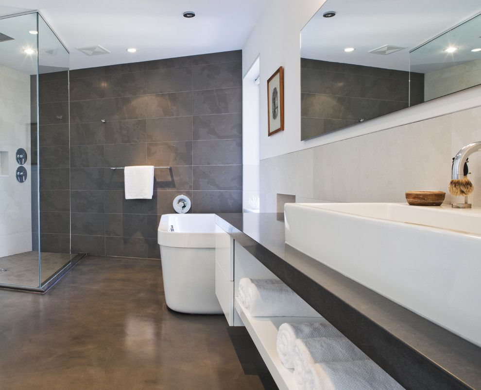 How to Lay Laminate Floor for a Modern Bathroom with a Celing Tub Filler and Echo Beach by Kbcdevelopments