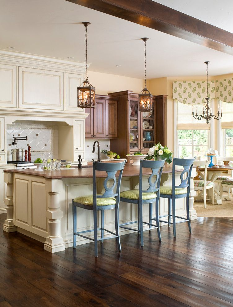 How to Lay Laminate Floor for a Transitional Kitchen with a White Tile Backsplash and Transitional Tudor by Design Transformations