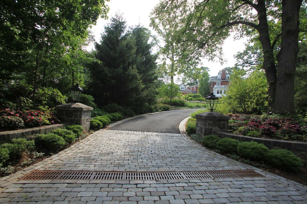 How to Lay Pavers for a Traditional Landscape with a Shade Garden and Cobblestone Entry with Stone Piers and Walls by the Todd Group