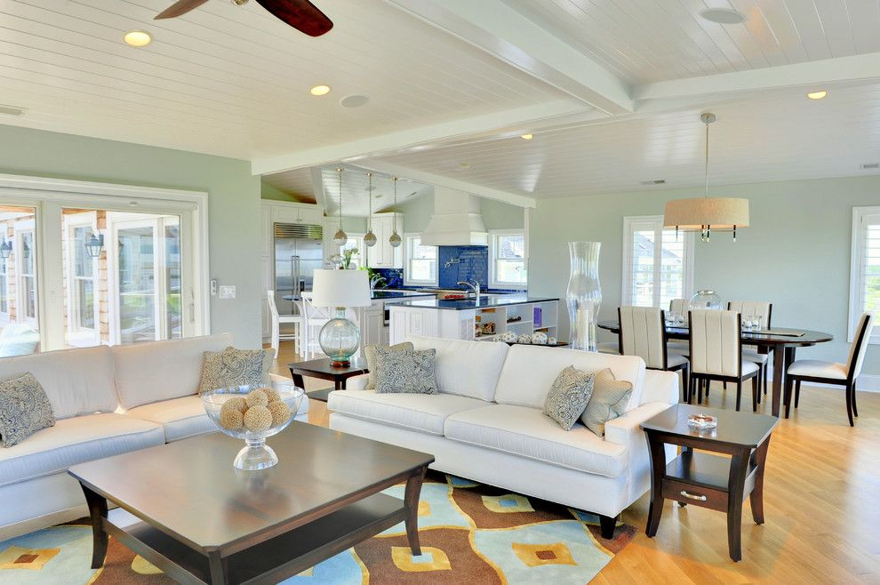 How to Paint a Popcorn Ceiling for a Beach Style Living Room with a Area Rug and Living Room by Echelon Custom Homes