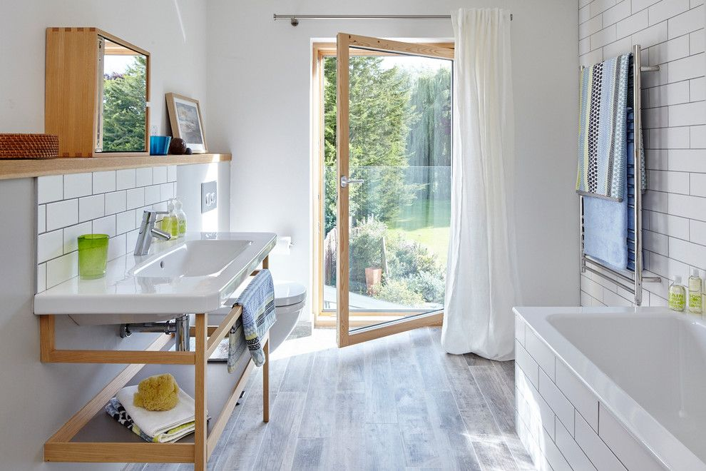 How to Refinish Wood Floors for a Contemporary Bathroom with a Towel Rail and Contemporary Country House in Berkshire by Lucy Crockett Design