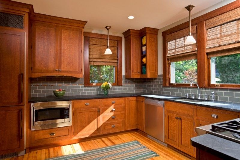How to Restain Cabinets for a Traditional Kitchen with a Traditional and Culinary Craftsman by Teakwood Builders, Inc.