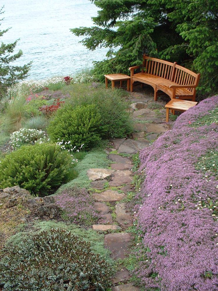 Howard Hill Furniture for a Beach Style Landscape with a Purple Flowers and San Juan Island Waterfront Residence   Project 157 by Island Gardens Company