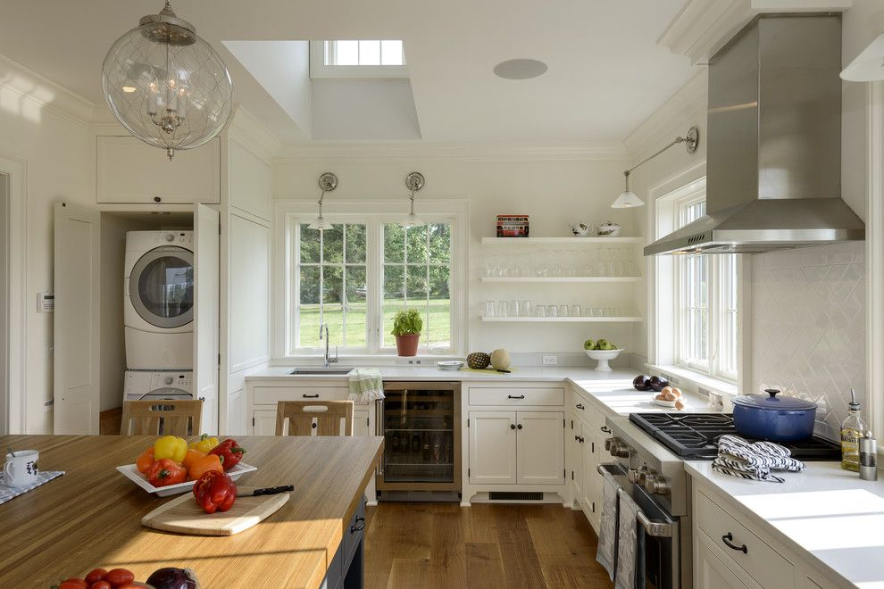 Hudson Appliance for a Farmhouse Kitchen with a Laundry in Kitchen and Pool House in the Country by Crisp Architects