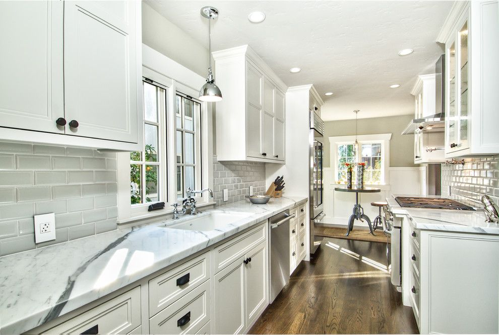 Hudson Appliance for a Traditional Kitchen with a Bridge Faucet and Land Park Tudor Revival by Creative Eye Design + Build, Leed Ap, Cgbp