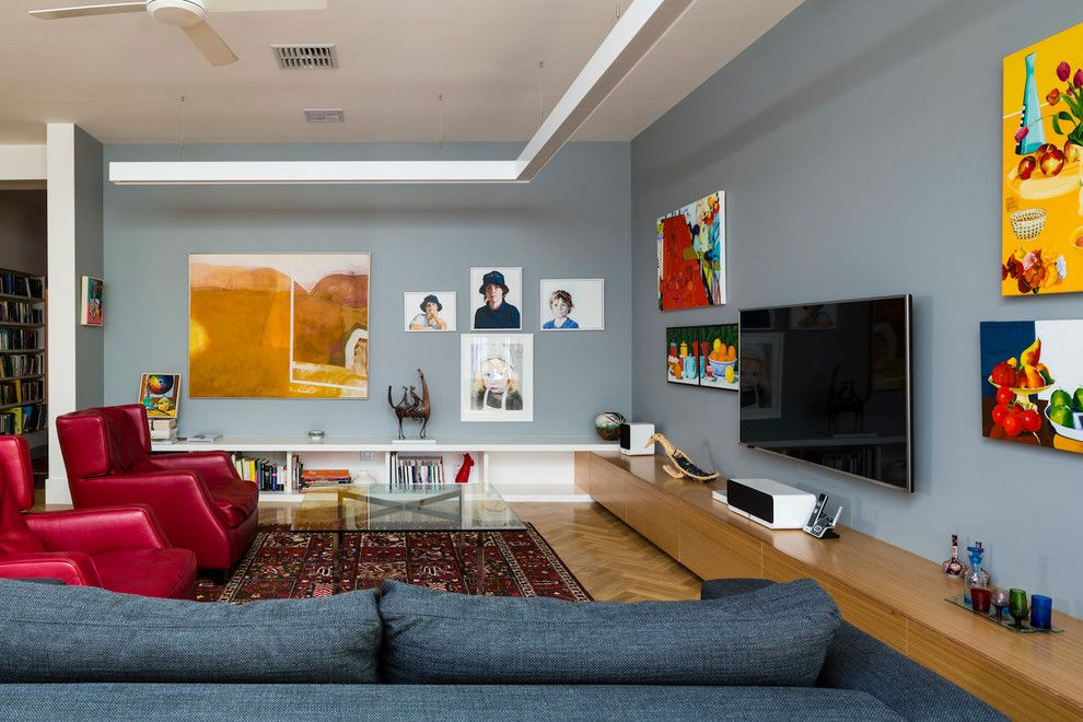 Hyde Park Pittsburgh for a Eclectic Family Room with a Red Armchair and Hyde Park Studio by Grieve Gillett Andersen
