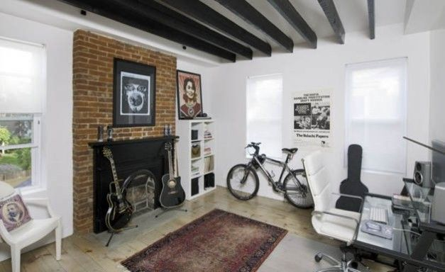 Ikea Cleveland for a Contemporary Home Office with a Exposed Brick and Rock Out by Housetrends Magazine