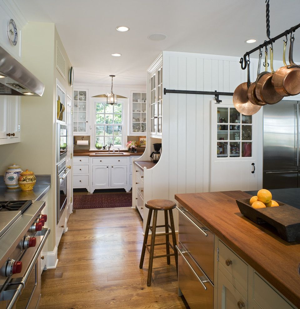 Ikea Dishwasher for a Traditional Kitchen with a Stool and Canary Cottage - Kitchen by Archer & Buchanan Architecture, Ltd.