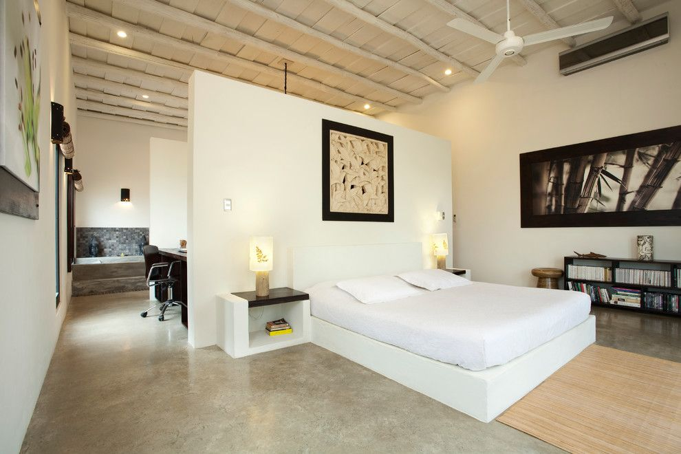 Ikea Lack Side Table for a Modern Bedroom with a Wood Ceiling Beams and Casa Kanda by Abc Real Estate Costa Rica