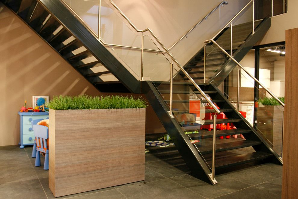 Ikea Planters for a Contemporary Staircase with a Wood Planter and Straight Stairs with Stone Treads and Glass Railing by Eestairs America Inc