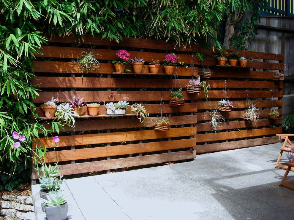 Ikea Planters for a Modern Patio with a Wood Slat Wall and Mtla   Broida Residence by Mtla  Mark Tessier Landscape Architecture