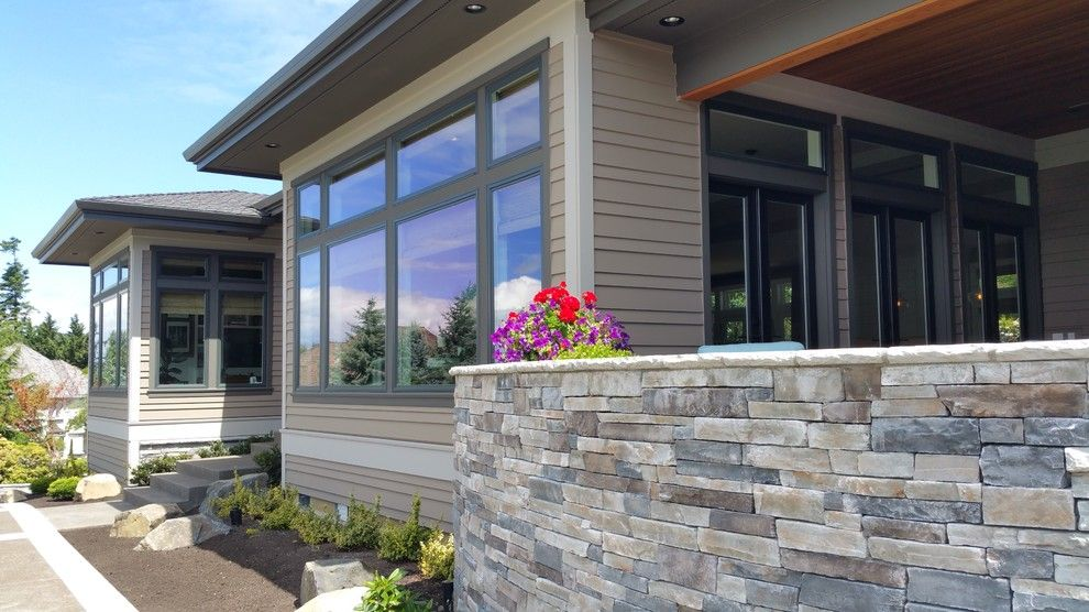 Ikea Portland Oregon for a Midcentury Exterior with a Rustic Stone and North West Portland Home by Portland Millwork, Inc.