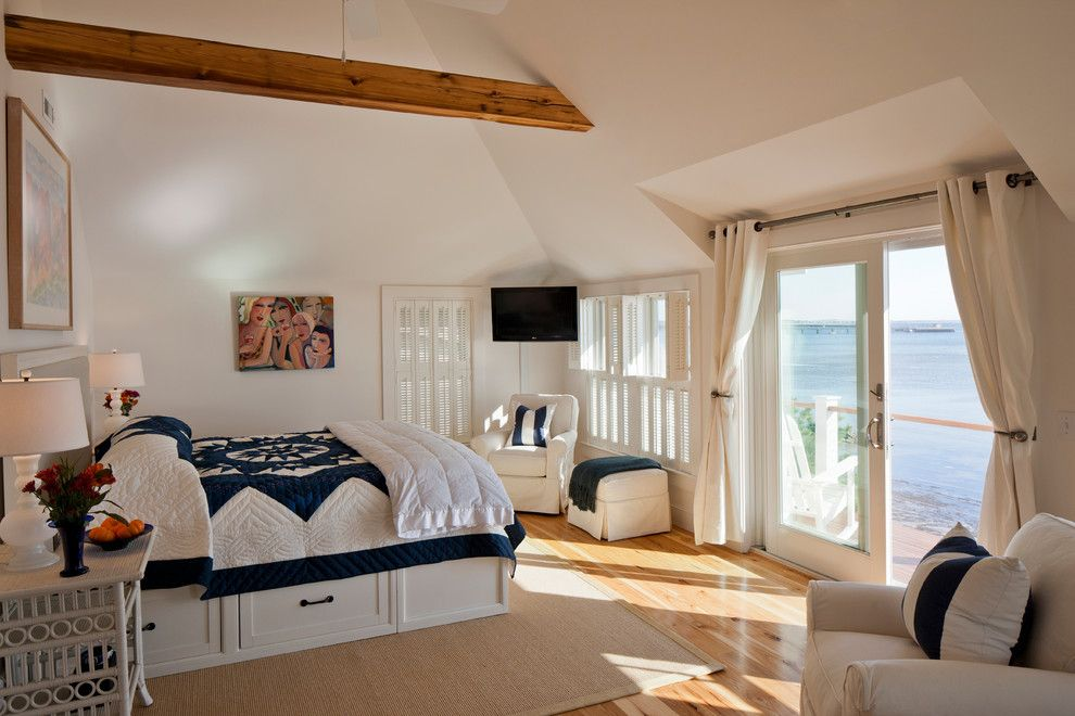 Ikea Slatted Bed Base for a Beach Style Bedroom with a White Arm Chair and Provincetown Beach House by Peter Mcdonald Architect