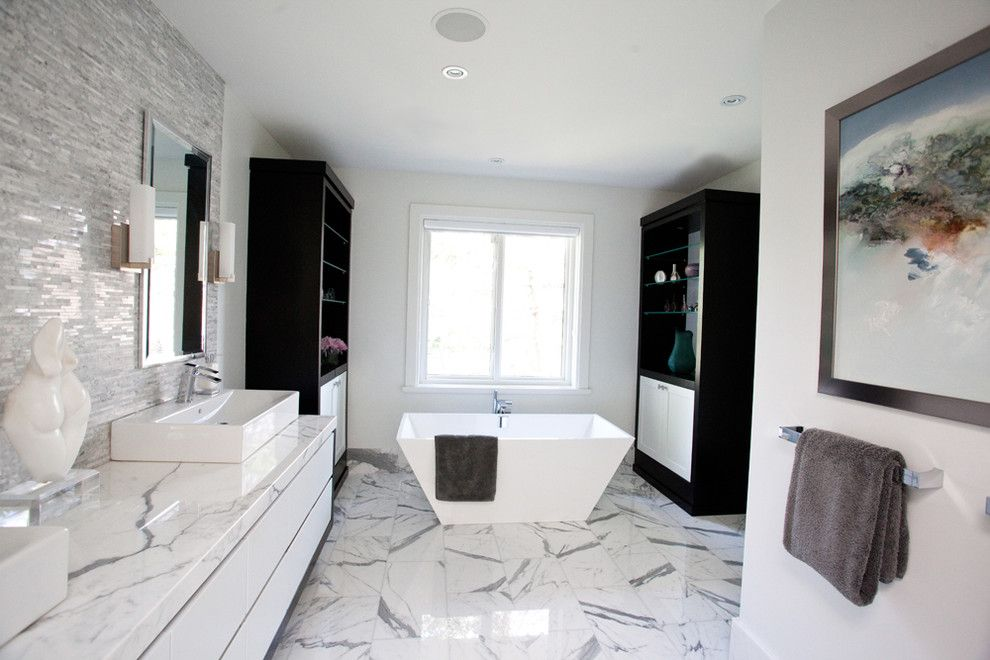 Installing a Bathtub for a Modern Bathroom with a Ceiling Lighting and Storm Residence by Jodie Rosen Design