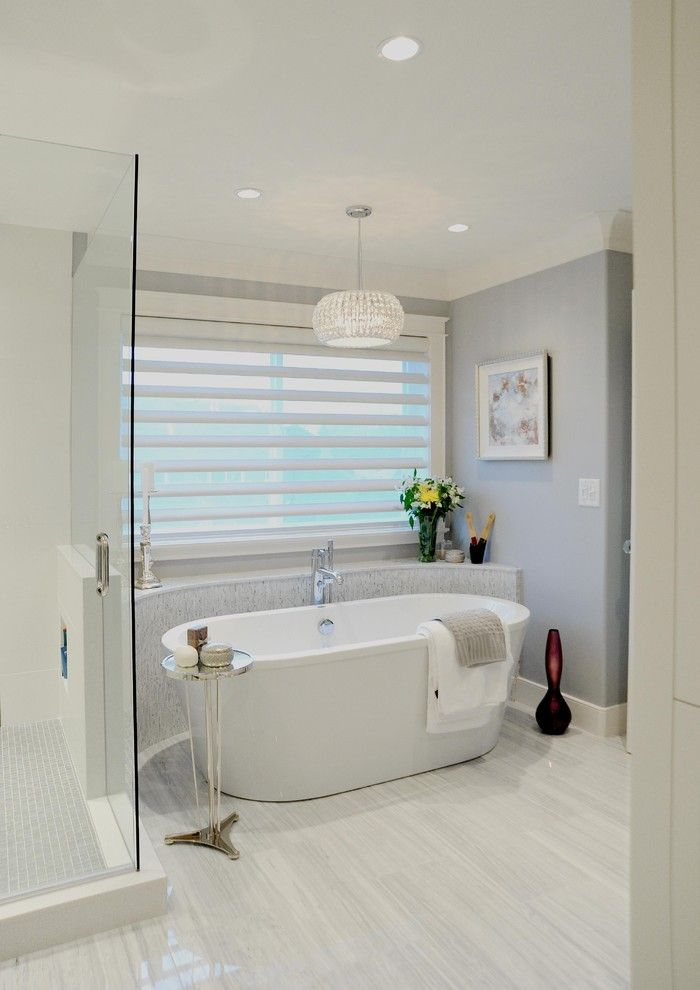Installing a Bathtub for a Traditional Bathroom with a Blinds and White Rock by Enviable Designs Inc.