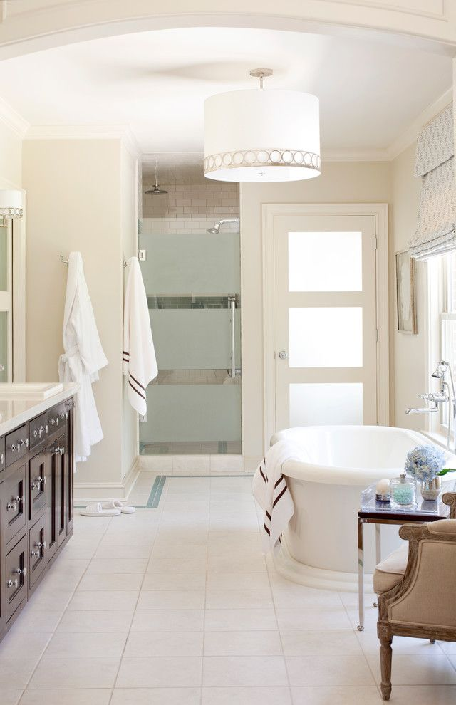 Installing a Bathtub for a Transitional Bathroom with a Rain Shower Head and Pleasant Valley by Tobi Fairley Interior Design
