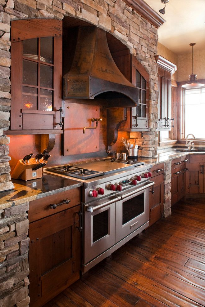 Installing a Wood Stove for a Rustic Kitchen with a Metal Range Hood and Rendezvous by Terra Firma Custom Homes