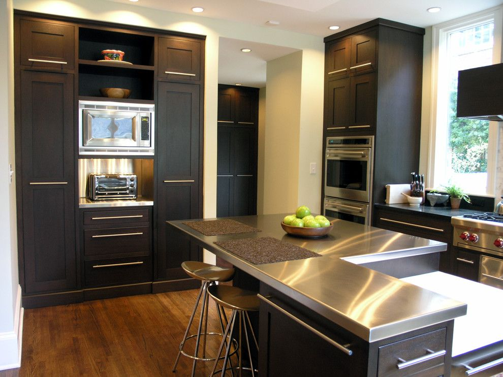 Installing Laminate Countertops for a Contemporary Kitchen with a Dark Brown Drawers and Modern Sleek Kitchen by Dci Home Resource
