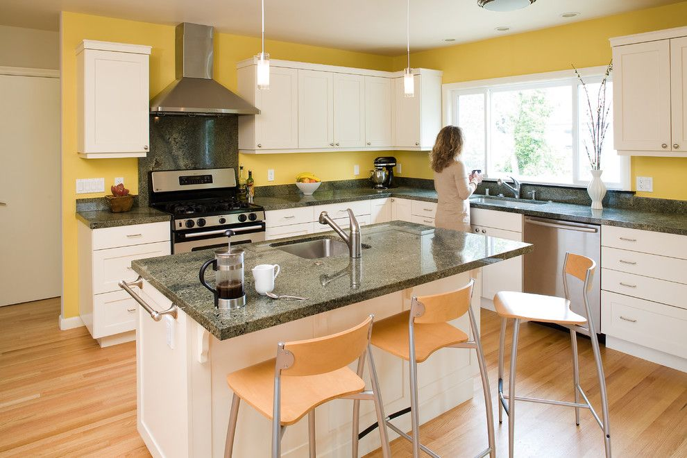 Installing Laminate Countertops for a Contemporary Kitchen with a Open Floor Plan and Modern Arts & Crafts Kitchen with Painted Shaker Style Cabinets by Mn Builders