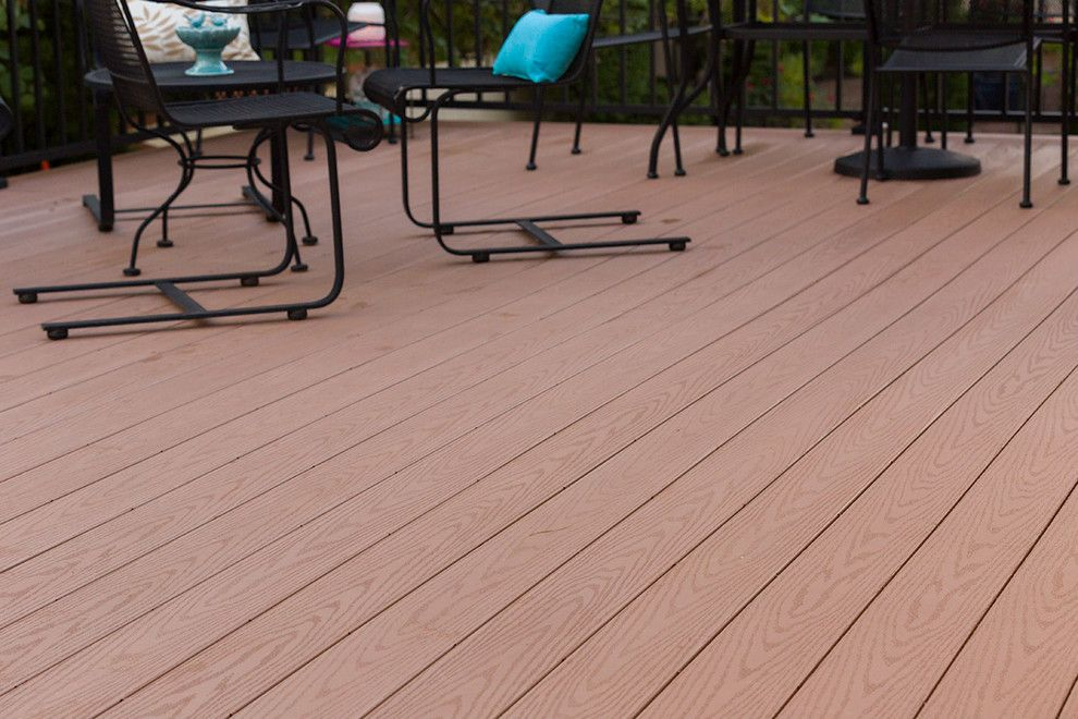 Inteplast for a Traditional Deck with a Stone Retaining Wall and Beautiful Decks by Creative Concepts & Design, Llc