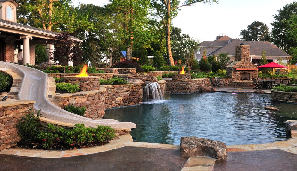 Interfab for a Traditional Pool with a Waterslide and Eads Natural Pool & Backyard Resort by J. Brownlee Design