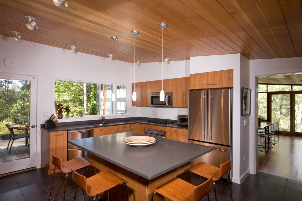 Intermountain Wood Products for a Midcentury Kitchen with a Dark Tile Floor and Mid Century Modern Addition, Truro by Hammer Architects