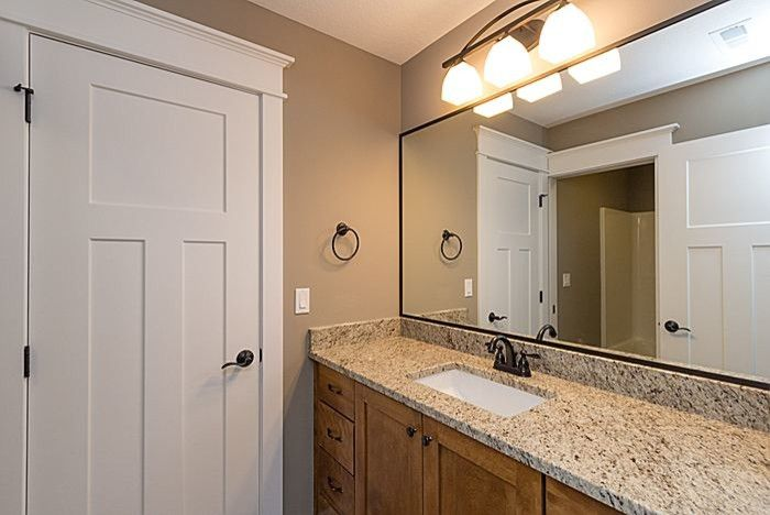 Iowa Realty Des Moines Ia for a Traditional Bathroom with a New Construction and Redrock Plan  Jack and Jill Bath by Teal Creek Homes
