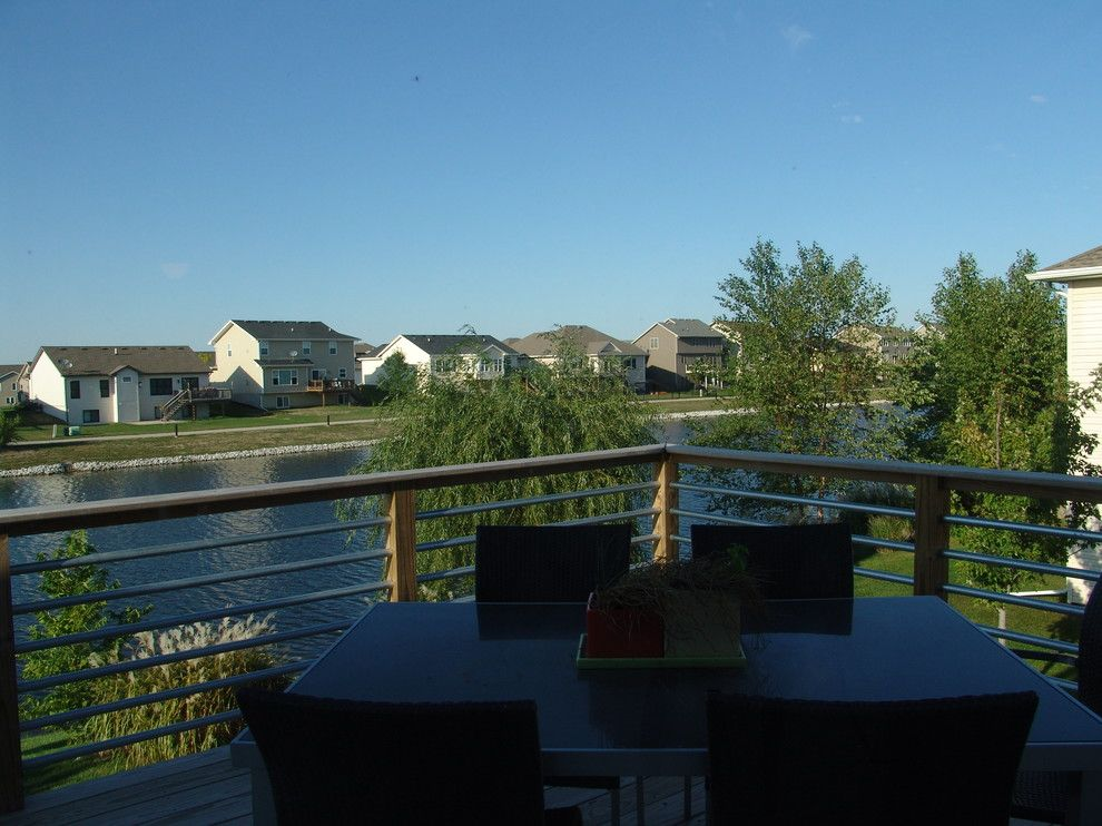 Iowa Realty Des Moines Iowa for a Contemporary Deck with a Kitchen and Wetzell Residence   Des Moines Area by Concepts in Design Inc.