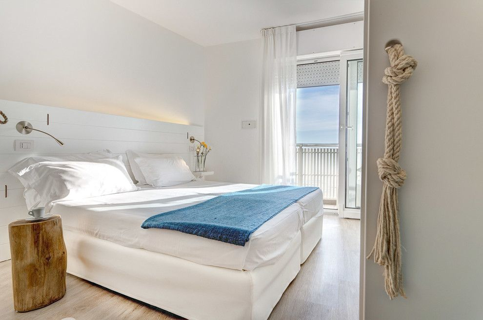 Ippolitos for a Beach Style Bedroom with a Beach Style and Hotel Solemare   Cervia (Ra) by Luca Ippolito