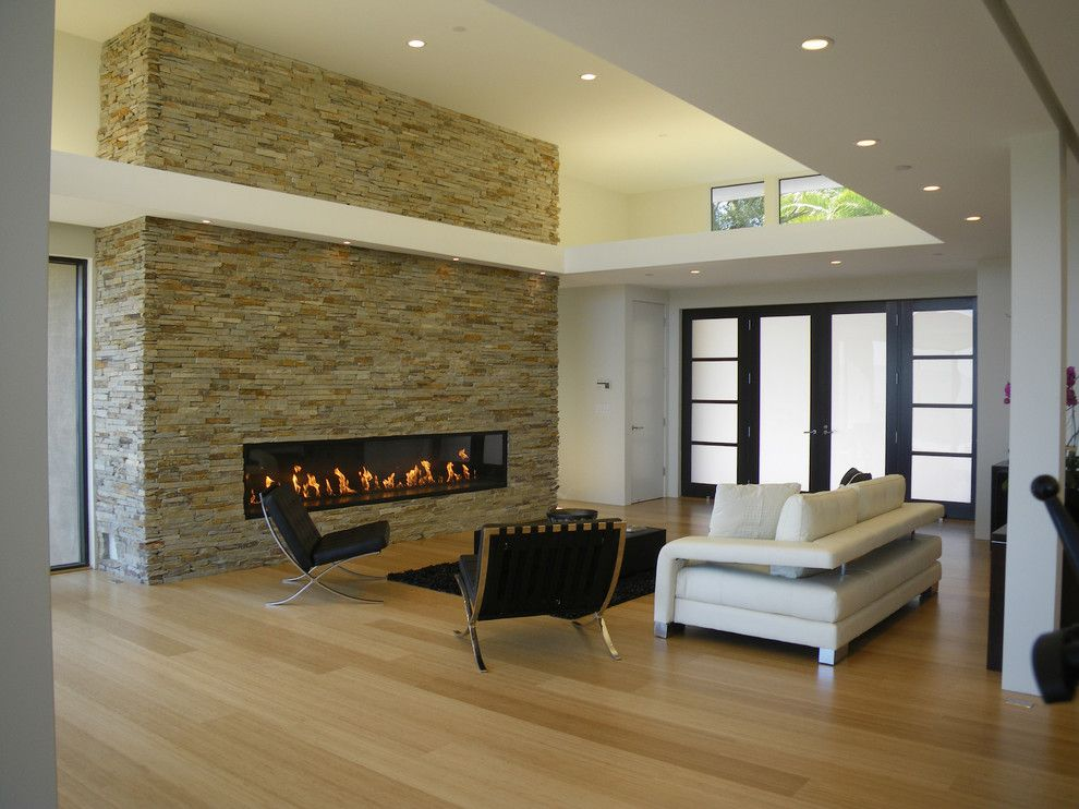 Jadon for a Modern Living Room with a Stone Wall and Olive Tree Lane by Mark English Architects, Aia