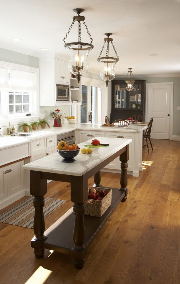 Jadon for a Traditional Kitchen with a Hardwood Floor and Tiburon Home Remodel by Mahoney Architects & Interiors