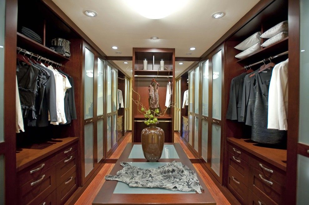 Janets Closet for a Contemporary Closet with a Sliding Doors and Featured in Gentry Design, Palo Alto Weekly Home & Garden and Others by Danenberg Design